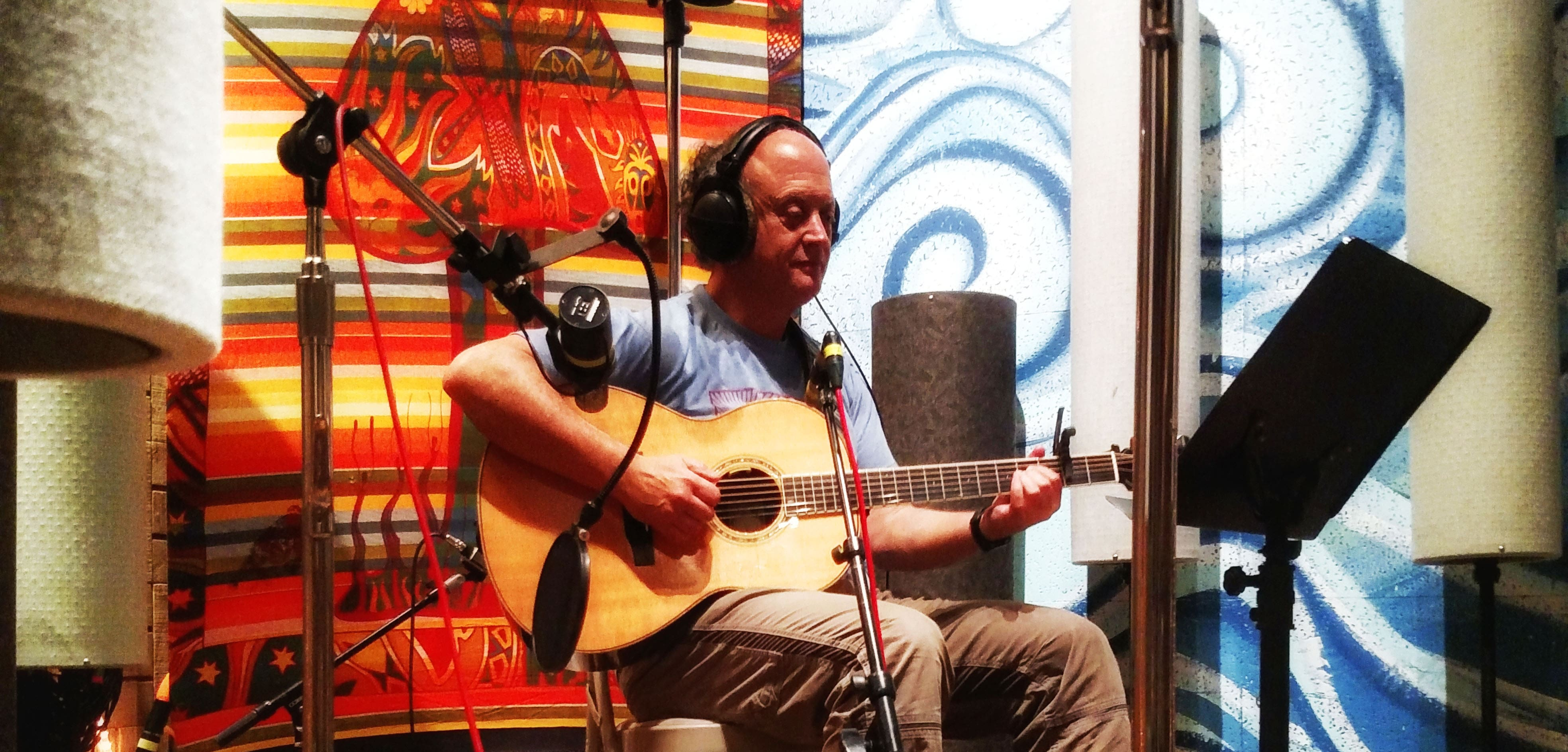 Kirk recording with his guitar in the Castaway 7 recording studio